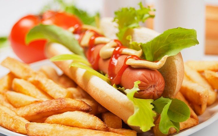 Hot dog with lettuce and french fries, selective focus